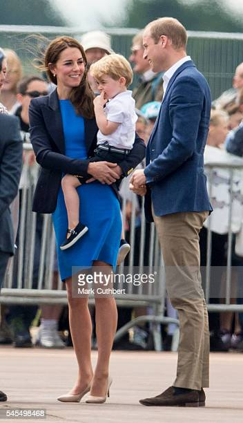 Catherine Duchess of Cambridge and Prince William Duke of Cambridge with Prince George of Cambridge during a visit to The Royal International Air...