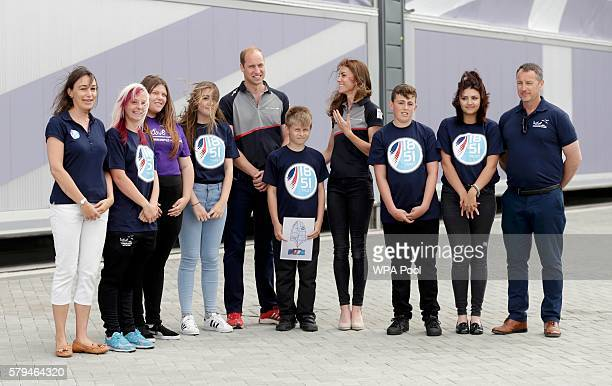 Catherine Duchess of Cambridge and Prince William Duke of Cambridge pose for a photo with the 1851 Trust during a visit Land Rover BAR at the...
