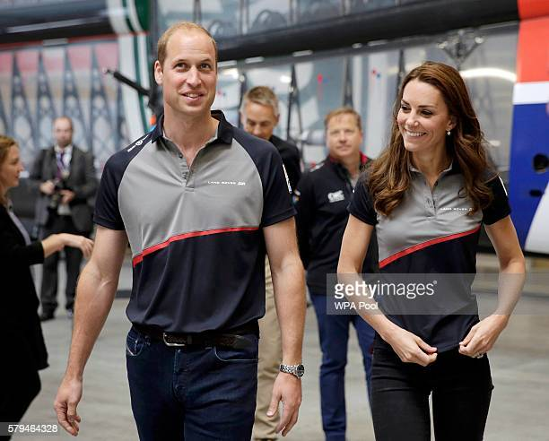 Catherine Duchess of Cambridge and Prince William Duke of Cambridge tour the Land Rover BAR boat shed during a visit Land Rover BAR at the America's...