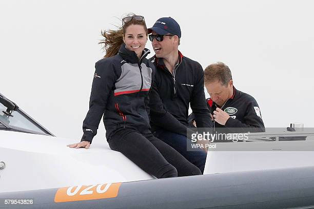 Catherine Duchess of Cambridge and Prince William Duke of Cambridge ride in the front of a boat as they watch the America's Cup World Series Race on...