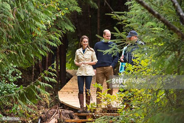 Catherine Duchess of Cambridge and Prince William Duke of Cambridge walk through the Great Bear Rainforest in Bella Bella Canada during the third day...