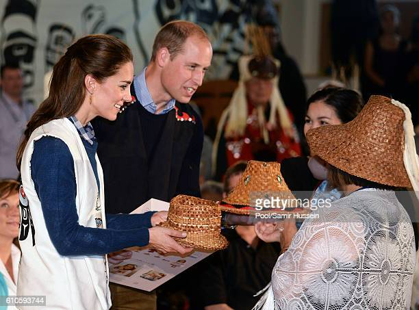 Catherine, Duchess of Cambridge and Prince William, Duke of Cambridge receive gifts as they attend an official welcome and performance from Bella...