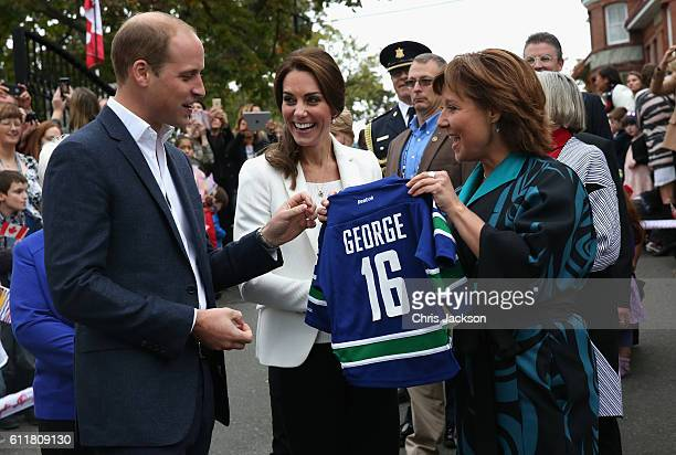 Catherine, Duchess of Cambridge and Prince William Duke of Cambridge are presented with personalised sports shirts for Prince George and Princess...