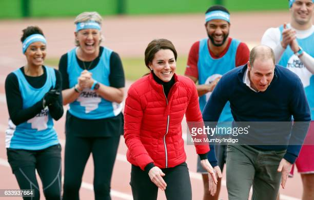 Catherine Duchess of Cambridge and Prince William Duke of Cambridge take part in a running race against Prince Harry as they join a Team Heads...