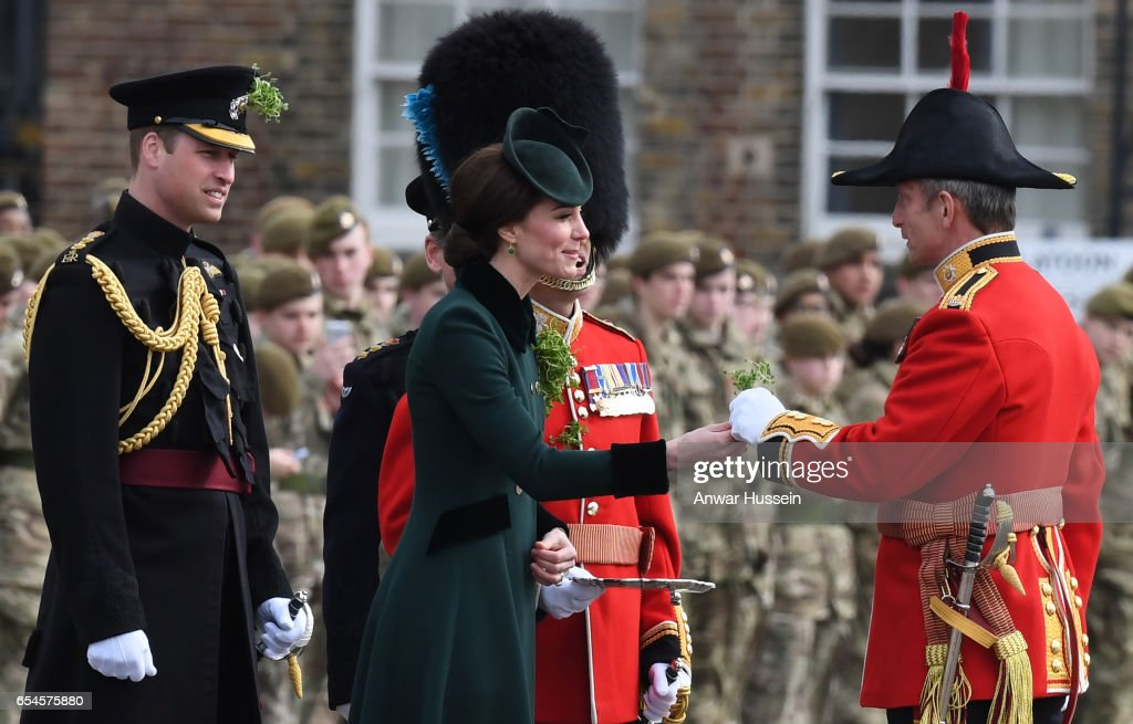 Catherine, Duchess of Cambridge and Prince William, Duke Of Cambridge present the 1st Battalion Irish Guardsmen with shamrocks during the annual Irish Guards St Patrick's Day Parade at Household Cavalry Barracks on March 17, 2017 in London, England.