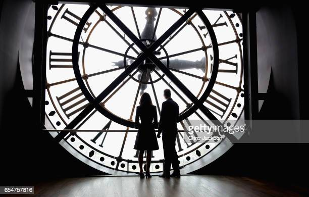 Catherine Duchess of Cambridge and Prince William Duke of Cambridge look through the clock at Musee d'Orsay during an official twoday visit to Paris...