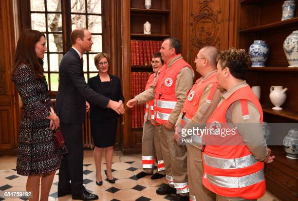 Catherine Duchess of Cambridge and Prince William Duke of Cambridge meet some paramedics as they visit Les Invalides military hospital during an...