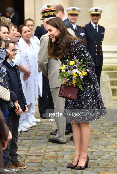 Catherine Duchess of Cambridge and Prince William Duke of Cambridge greet the crowds as they visit Les Invalides military hospital during an official...