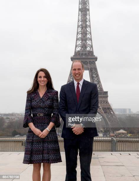 """Catherine, Duchess of Cambridge and Prince William, Duke of Cambridge pose in front of the Eiffel tower as they visit a """"Les Voisins in Action"""" event..."""