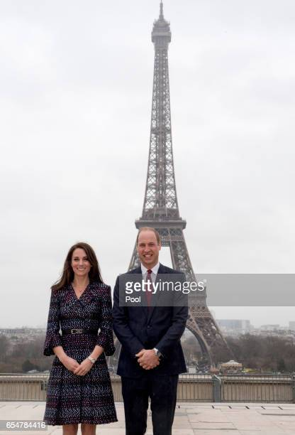 Catherine Duchess of Cambridge and Prince William Duke of Cambridge pose in front of the Eiffel tower as they visit a Les Voisins in Action event...