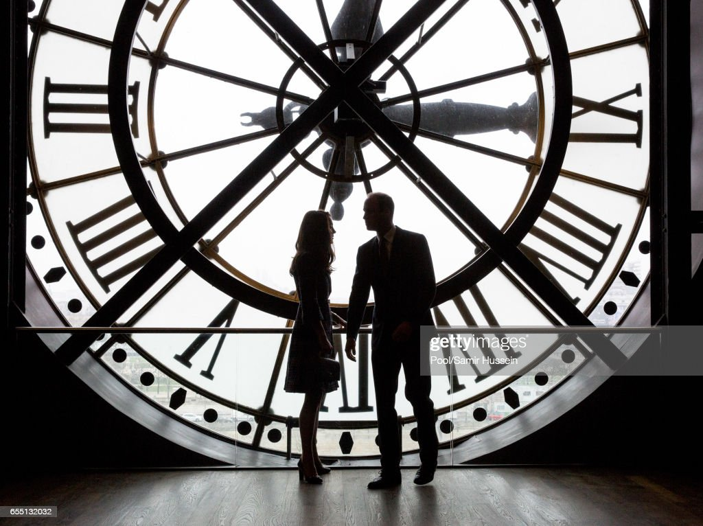 Catherine, Duchess of Cambridge and Prince William, Duke of Cambridge look through the clock as they visit Musee d'Orsay on March 18, 2017 in Paris, France. The Duke and Duchess are on a two day tour of France.