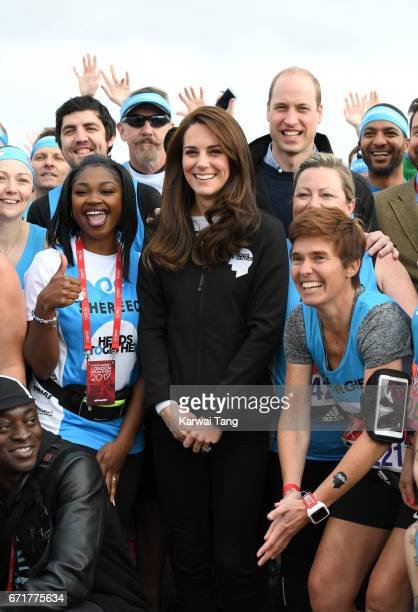 Catherine, Duchess of Cambridge and Prince William, Duke of Cambridge meet Heads Together runners in the Blue Start area as they prepare for the 2017...