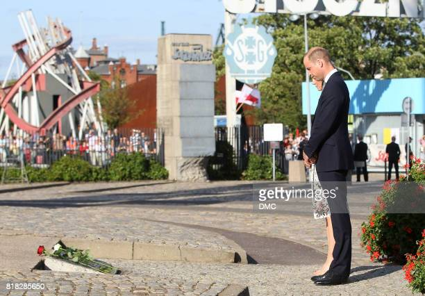 Catherine Duchess of Cambridge and Prince William Duke of Cambridge are seen while paying their respect at the Solidarity Monument during an official...