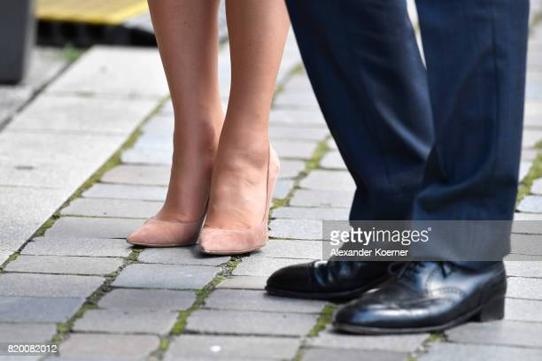 Catherine Duchess of Cambridge and Prince William Duke of Cambridge fashion detail arrive for a visit of the Maritime Museum on the third and final...