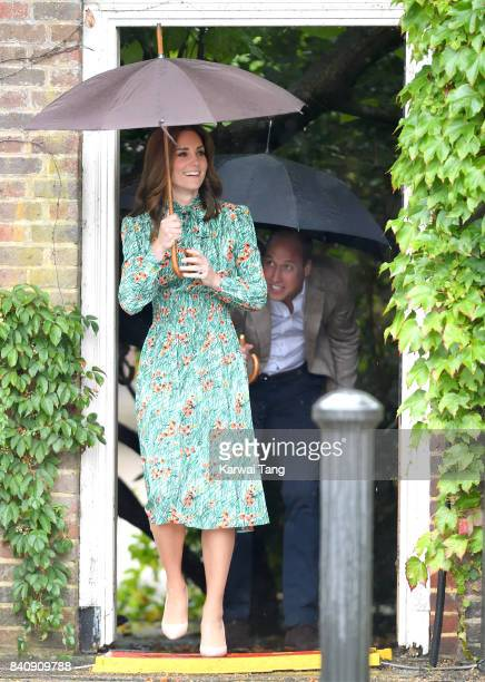 Catherine Duchess of Cambridge and Prince William Duke of Cambridge are seen during a visit to The Sunken Garden at Kensington Palace on August 30...