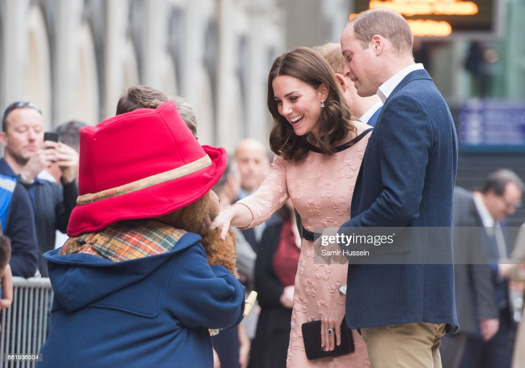 Catherine, Duchess of Cambridge and Prince William, Duke of Cambridge meet Paddington Bear as she attends the Charities Forum Event on board the Belmond Britigh Pullman train at Paddington Station on October 16, 2017 in London, England.