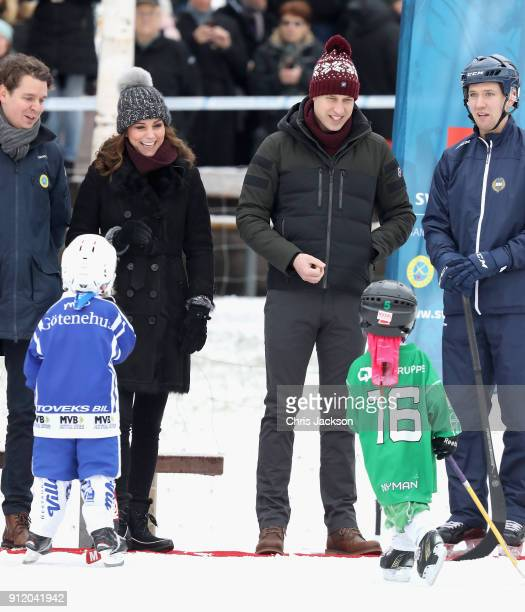 Catherine Duchess of Cambridge and Prince William Duke of Cambridge meet young players as they attend a Bandy hockey match where they will learn more...