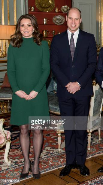 Catherine Duchess of Cambridge and Prince William Duke of Cambridge pose ahead of a lunch at the Royal Palace of Stockholm during day one of their...