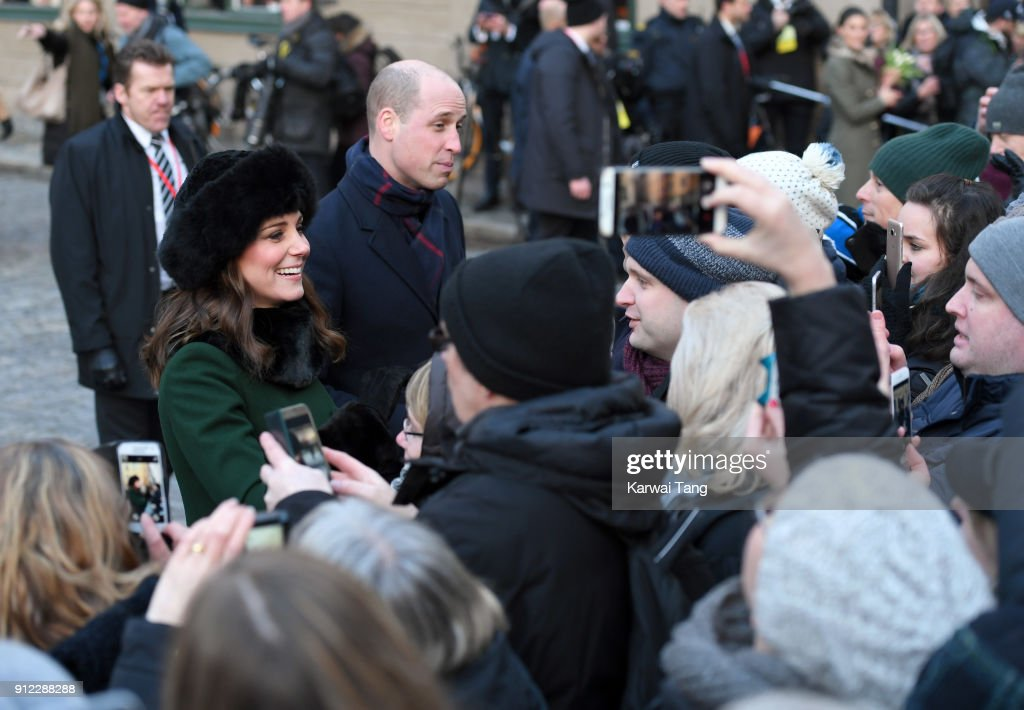 Catherine, Duchess of Cambridge and Prince William, Duke of Cambridge during a walkabout through the cobbled streets of Stockholm from the Royal Palace to the Nobel Museum during day one of their Royal visit to Sweden and Norway on January 30, 2018 in Stockholm, Sweden.