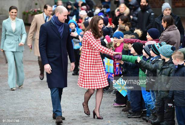 Catherine, Duchess of Cambridge and Prince William, Duke of Cambridge depart from Matteusskolan School after visiting children who have taken part in...