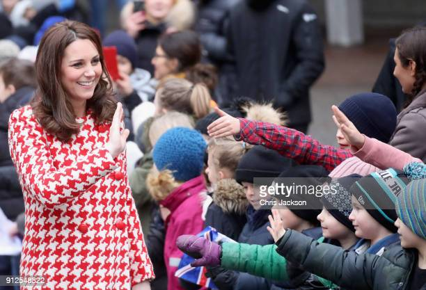 Catherine Duchess of Cambridge and Prince William Duke of Cambridge depart from Matteusskolan School after visiting children who have taken part in...