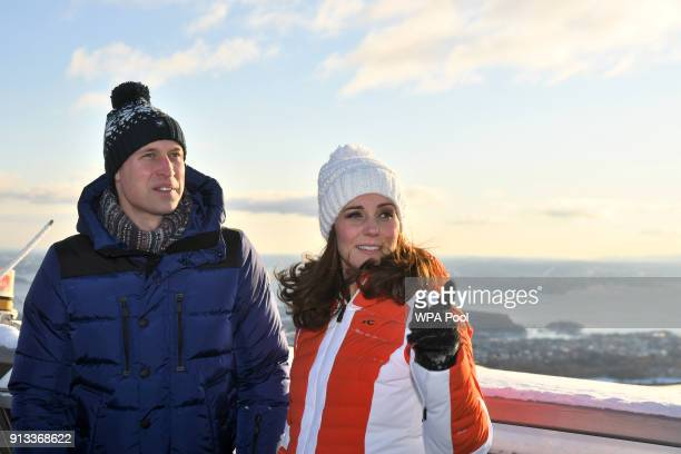 Catherine Duchess of Cambridge and Prince William Duke of Cambridge before meeting junior ski jumpers from Norway's national team at the top of the...