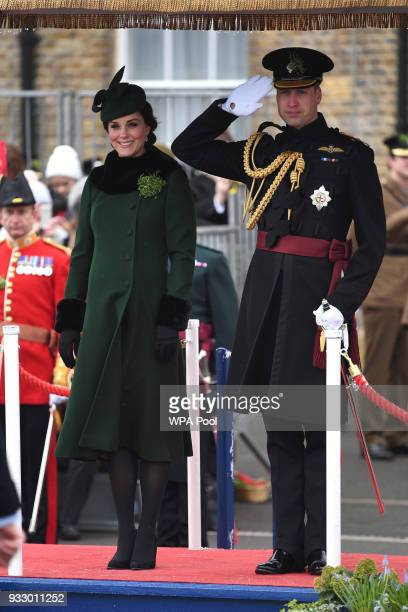 Catherine Duchess of Cambridge and Prince William Duke Of Cambridge stand on the dias during the annual Irish Guards St Patrick's Day Parade at...