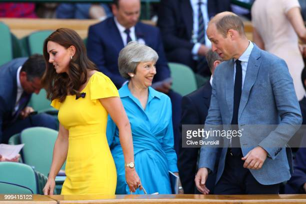 Catherine, Duchess of Cambridge and Prince William, Duke of Cambridge pass British Prime Minister Theresa May as they attend the Men's Singles final...