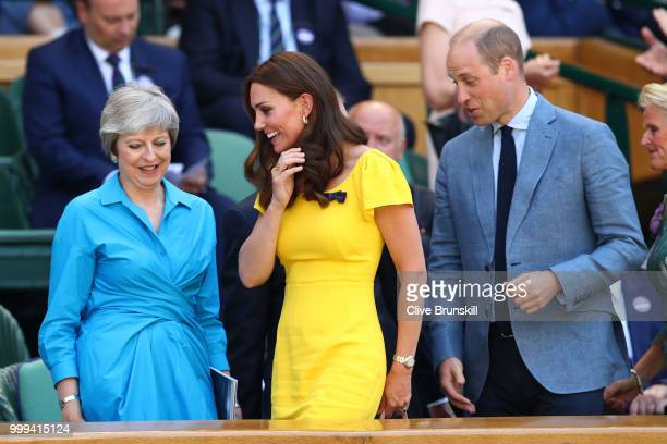 Catherine Duchess of Cambridge and Prince William Duke of Cambridge pass British Prime Minister Theresa May as they attend the Men's Singles final on...