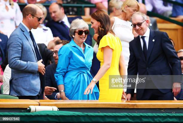 Catherine Duchess of Cambridge and Prince William Duke of Cambridge with British Prime Minister Theresa May and her husband Philip May as they attend...