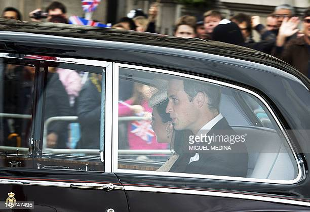 Catherine Duchess of Cambridge and Prince William pass Trafalgar Square en route to St Paul's Cathedral during the Queen's Diamond Jubilee in London...
