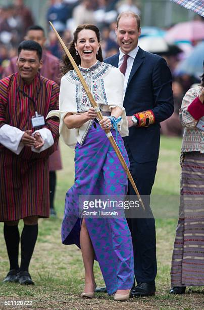 Catherine Duchess of Cambridge and Prince William react as they take part in archery at Thimphu's openair archery venue on April 14 2016 in Thimphu...