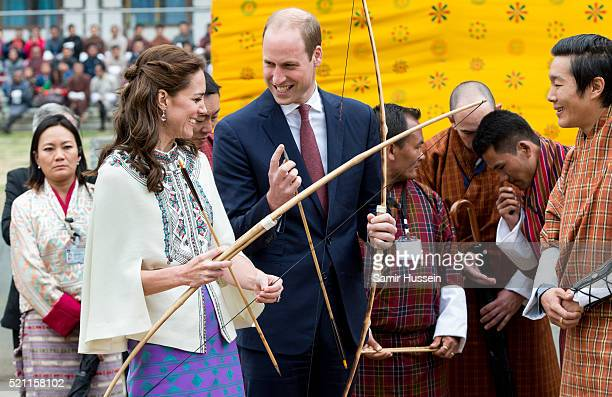 Catherine Duchess of Cambridge and Prince William take part in archery at Thimphu's openair archery venue on April 14 2016 in Thimphu Bhutan