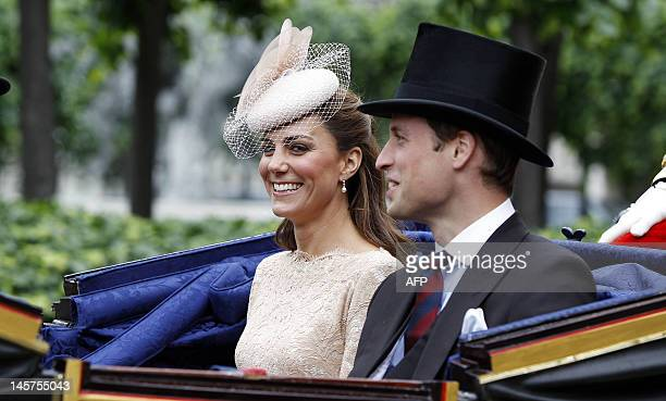 Catherine Duchess of Cambridge and Prince William travel on a carriage to leave Westminster Hall after a Diamond Jubilee Luncheon during the carriage...
