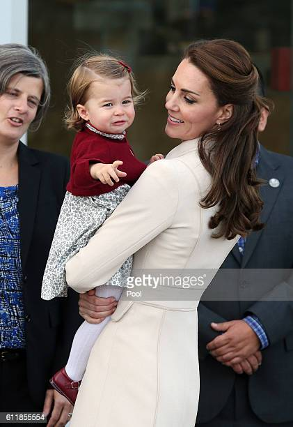 Catherine, Duchess of Cambridge and Princess Charlotte attend a ceremony to mark their departure at Victoria Harbour seaplane terminal in Victoria...