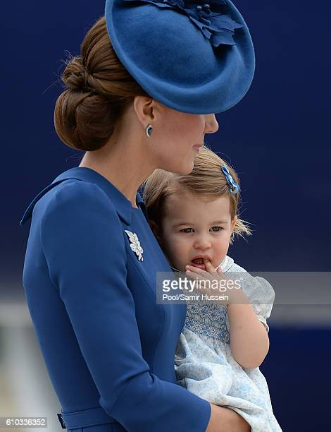 Catherine Duchess of Cambridge and Princess Charlotte fo Cambridge arrive at Victoria Airport for the start of the Royal Tour on September 24 2016 in...