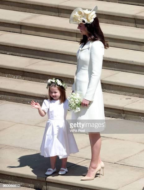 Catherine Duchess of Cambridge and Princess Charlotte leave St George's Chapel Windsor Castle after the wedding of Prince Harry Duke of Sussex and...