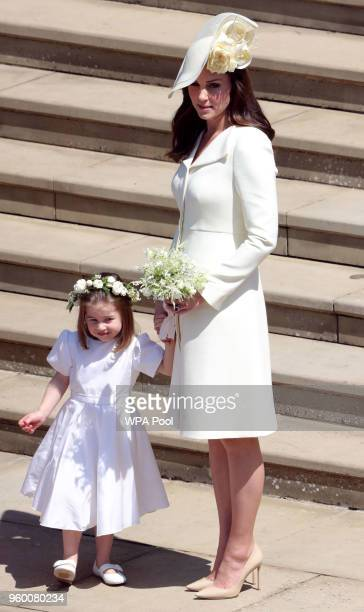 Catherine, Duchess of Cambridge and Princess Charlotte leave St George's Chapel, Windsor Castle after the wedding of Prince Harry, Duke of Sussex and...