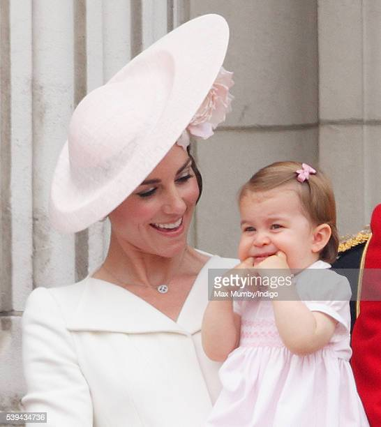 Catherine Duchess of Cambridge and Princess Charlotte of Cambridge stand on the balcony of Buckingham Palace during Trooping the Colour this year...