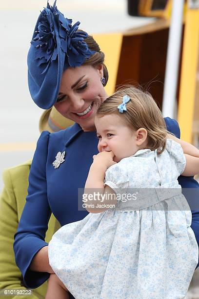 Catherine, Duchess of Cambridge and Princess Charlotte of Cambridge arrive at the Victoria Airport on September 24, 2016 in Victoria, Canada. Prince...