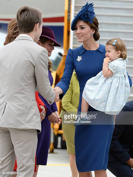 Catherine, Duchess of Cambridge and Princess Charlotte of Cambridge arrive at Victoria Airport for the start of the Royal Tour on September 24, 2016...