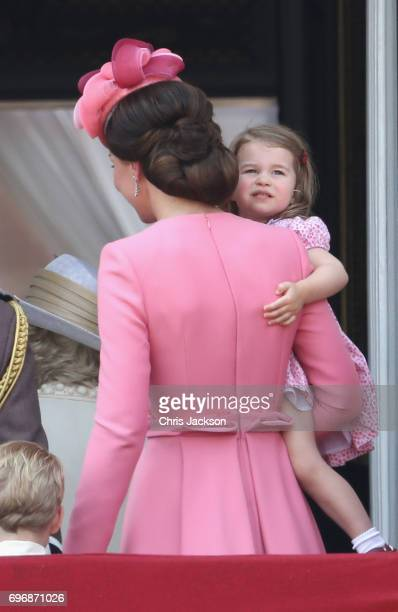 Catherine Duchess of Cambridge and Princess Charlotte of Cambridge leave the balcony of Buckingham Palace after the Trooping the Colour parade on...