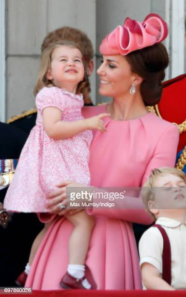 Catherine Duchess of Cambridge and Princess Charlotte of Cambridge watch the flypast from the balcony of Buckingham Palace during the annual Trooping...
