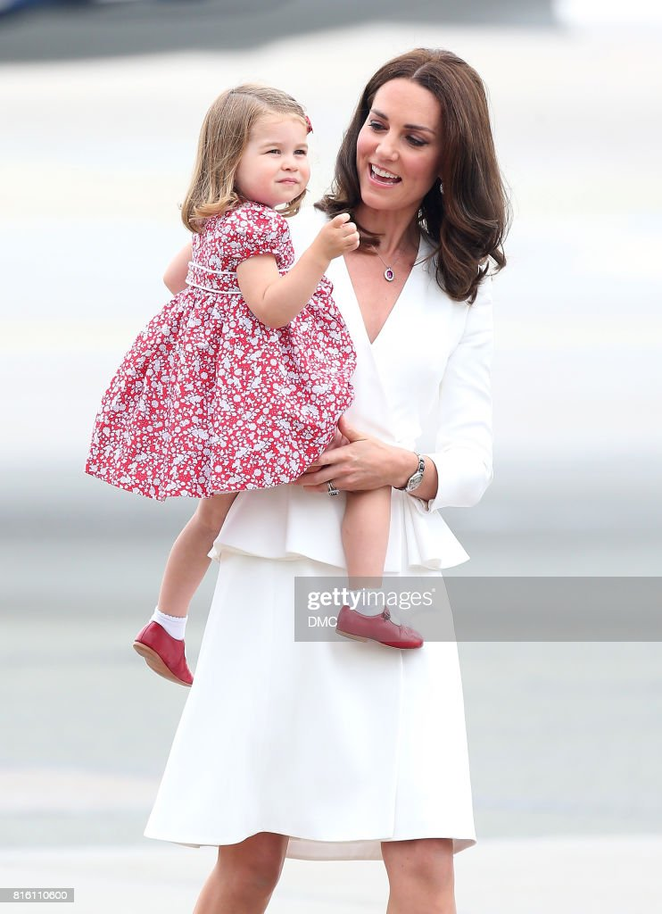 Catherine, Duchess of Cambridge and Princess Charlotte of Cambridge arrive at the airport during an official visit to Poland and Germany on July 17, 2017 in Warsaw, Poland.
