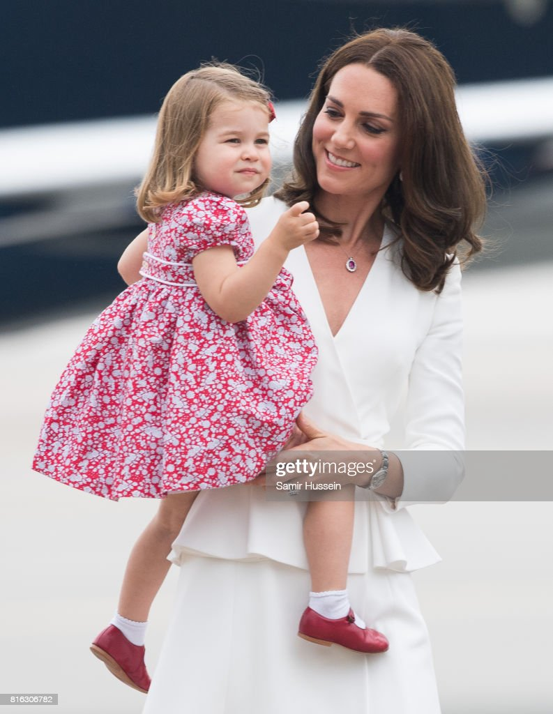 Catherine, Duchess of Cambridge and Princess Charlotte of Cambridge arrive at Warsaw airport during an official visit to Poland and Germany on July 17, 2017 in Warsaw, Poland.