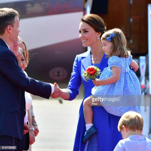 Catherine Duchess of Cambridge and Princess Charlotte of Cambridge arrive at Berlin Tegel Airport during an official visit to Poland and Germany on...