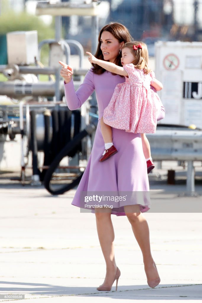 Catherine, Duchess of Cambridge and Princess Charlotte of Cambridge view helicopter models H145 and H135 before departing from Hamburg airport on the last day of their official visit to Poland and Germany on July 21, 2017 in Hamburg, Germany.