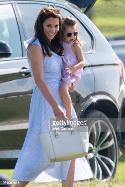 Catherine Duchess of Cambridge and Princess Charlotte of Cambridge during the Maserati Royal Charity Polo Trophy at Beaufort Park on June 10 2018 in...