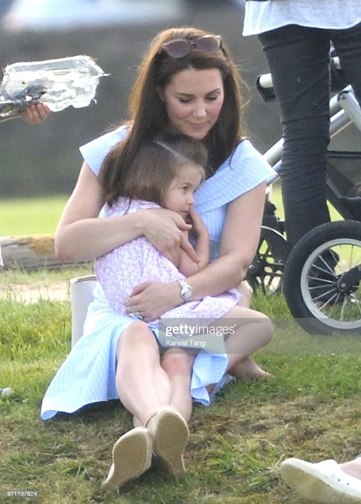 Catherine, Duchess of Cambridge and Princess Charlotte of Cambridge attend the Maserati Royal Charity Polo Trophy at Beaufort Park on June 10, 2018 in Gloucester, England.