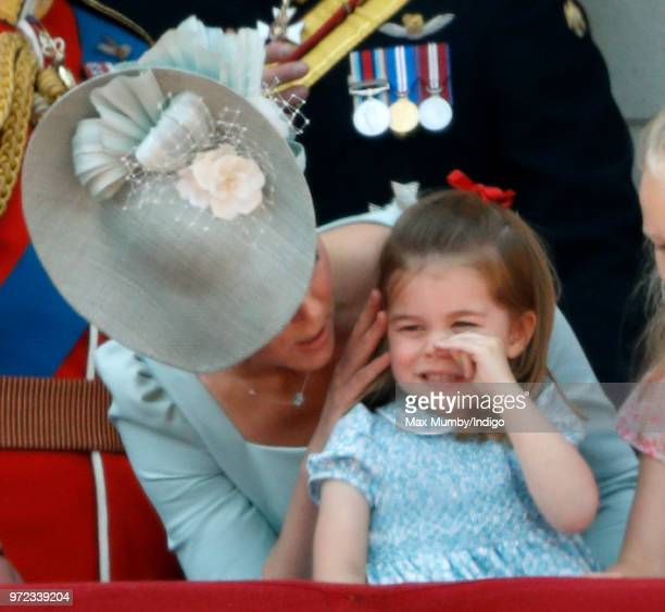 Catherine Duchess of Cambridge and Princess Charlotte of Cambridge stand on the balcony of Buckingham Palace during Trooping The Colour 2018 on June...